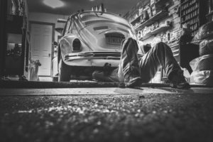 Man Working on Car in Garage | Floorguard.com