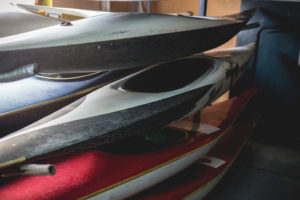 Stacked Kayaks Stored in a Home Garage | Floorguard.com