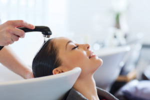 Woman Getting Hair Washed in Salon | Floorguard.com