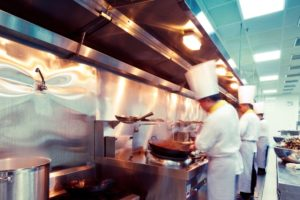Chefs Cooking Food in a Commercial Kitchen | Floorguard.com