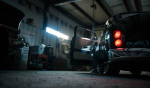 Illuminated Taillights on a Vintage Car in a Garage | Floorguard.com