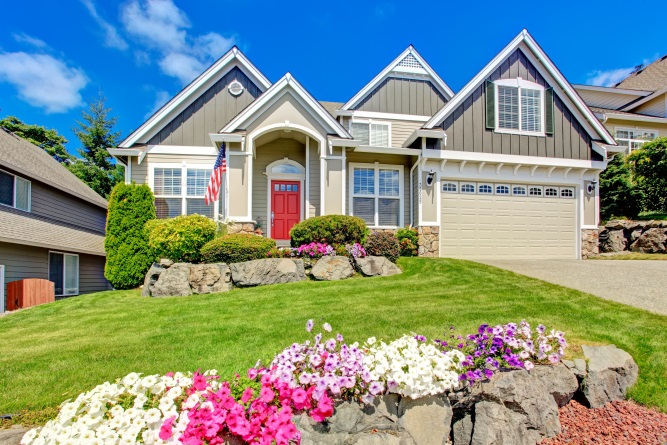 Gray Home with Flowers Out Front and a Two-Car Garage | Floorguard.com