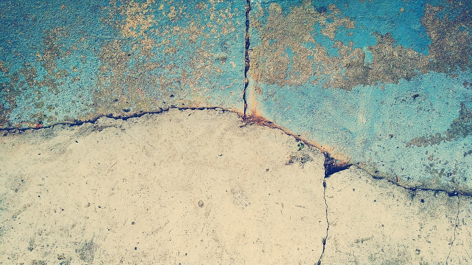Blue and Gray Concrete with Cracks in It | Floorguard.com