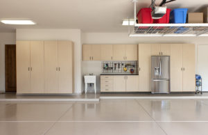 Beige Epoxy Floor Coating in a Garage with Cabinets | Floorguard.com