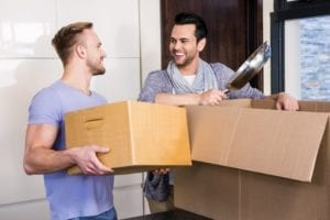 Two Men with Boxes Containing Household Items