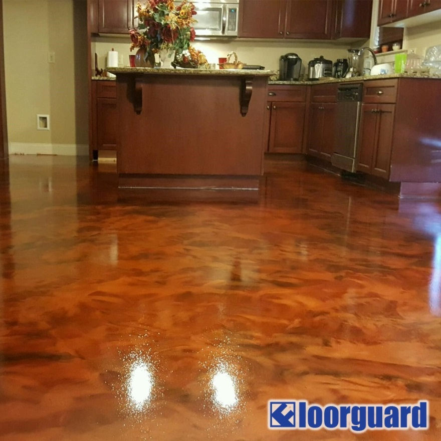 A Kitchen with a Brown Island and Brown Cabinets and Marbled Brown Epoxy Floor Coating