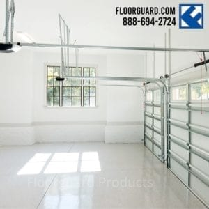Garage Interior with White Flaked Epoxy Floor Coating and Closed Double Garage Doors