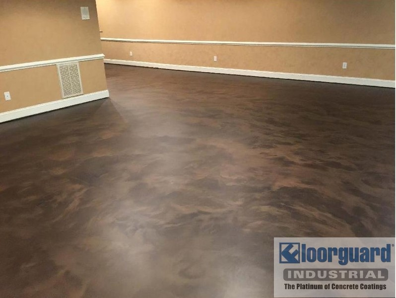 A picture of an empty room with epoxy flooring
