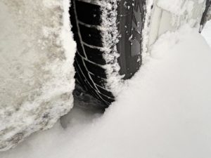 Vehicle tire covered in snow