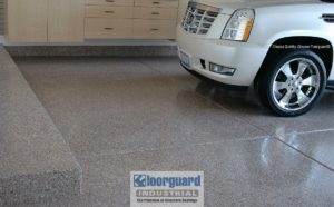 Floorguard epoxy floor in a garage with a vehicle parked inside.
